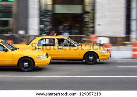 NEW YORK - AUG 9: Yellow NYC taxi cab in New York City on August 9, 2011. The taxicabs of New York City are a widely recognized icon of the city.