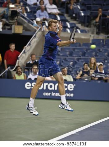 NEW YORK - AUGUST 30: Andrey Golubev of Kazakhstan returns ball during 1st round match against Rafael Nadal of Spain at USTA Billie Jean King National Tennis Center on August 30, 2011 in New York City