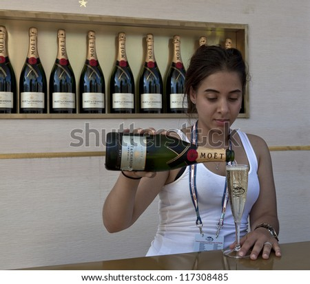 NEW YORK - AUGUST 28: Bartender serves Moet & Chandon flute of champagne at US Open tennis tournament on August 28, 2012 in Flushing Meadows New York - stock photo