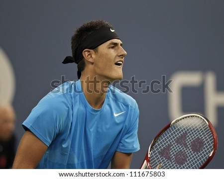 NEW YORK - AUGUST 31: Bernard Tomic of Australia returns ball during 2nd round match against Andy Roddick of USA at US Open tennis tournament on August 31, 2012 in Flashing Meadows New York