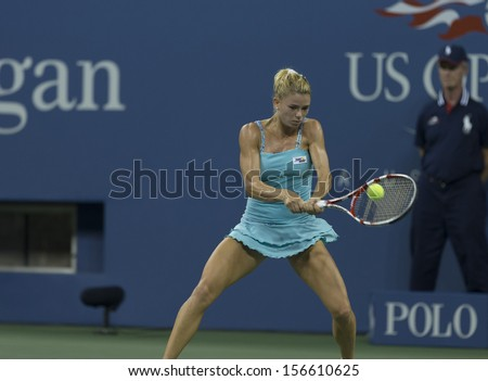 NEW YORK - AUGUST 31: Camila Giorgi of Italy returns ball during 3rd round match against Caroline Wozniacki of Denmark at 2013 US Open at USTA Billie Jean King Tennis Center on August 31, 2013 in NYC