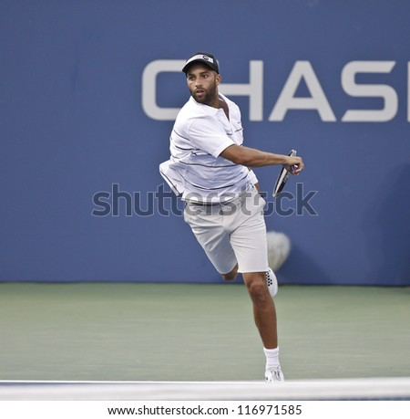 NEW YORK - AUGUST 30: James Blake of USA returns ball during 2nd round match against Marcel Granollers of Spain at US Open tennis tournament on August 30, 2012 in Flushing Meadows New York