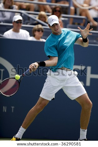 NEW YORK - AUGUST 31: John Isner of USA returns a shot during 1st round match against Victor Hanescu of Romania at US Open on August 31 2009 in New York