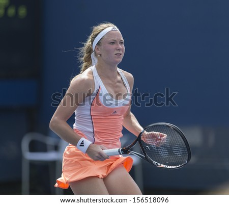 NEW YORK - AUGUST 31: Julia Glushko of Israel reacts during 3rd round match against Daniela Hantuchova of Slovakia at 2013 US Open at USTA Billie Jean King Tennis Center on August 31, 2013 in NYC