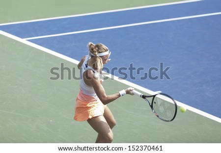 NEW YORK - AUGUST 31: Julia Glushko of Israel returns ball during 3rd round match against Daniela Hantuchova of Slovakia at 2013 US Open at USTA Billie Jean King Tennis Center on August 31 2013 in NYC