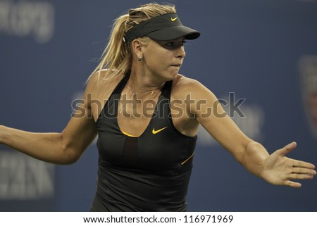 NEW YORK - AUGUST 29: Maria Sharapova of Russia returns ball during 2nd round match against Lourdes Dominguez Lino of Spain at US Open tennis tournament on Augist 29, 2012 in Flushing Meadows New York