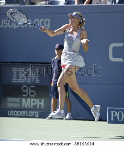 NEW YORK - AUGUST 29: Maria Sharapova of Russia returns ball during 1st round match against Heather Watson of United Kingdom at USTA Billie Jean King National Tennis Center on August 29, 2011 in NYC