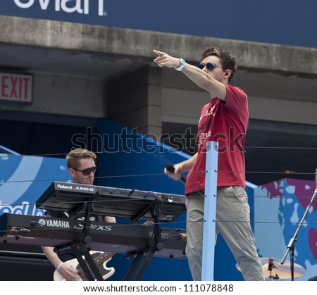 NEW YORK - AUGUST 25: Nathan Sykes of The Wanted performs at Kids Day at US Open tennis tournament sponsored by Hess on August 25, 2012 in Queens New York