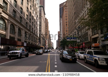 NEW YORK - AUGUST 24:  People and Media gather one block away after 2 killed and 8 injured in shooting near Empire State Building August 24, 2012  in New York City #110988458