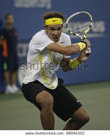 NEW YORK - AUGUST 30: Rafael Nadal of Spain returns ball during 1st round match against Andrey Golubev of Kazakhstan at USTA Billie Jean King National Tennis Center on August 30, 2011 in NYC