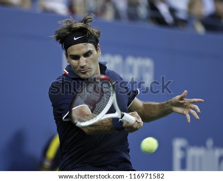 NEW YORK - AUGUST 30: Roger Federer of Switzerland returns ball during 2nd round match against Bjorn Phau of Germany at US Open tennis tournament on August 30, 2012 in Flushing Meadows New York