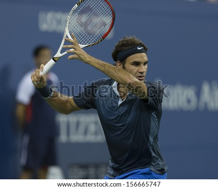 NEW YORK - AUGUST 31: Roger Federer of Switzerland returns ball during 3rd round match against  Adrian Mannarino of Italy at 2013 US Open at USTA Tennis Center on August 31, 2013 in NYC
