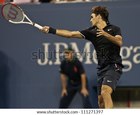 NEW YORK - AUGUST 27: Roger Federer of Switzerland returns ball during 1st round match against Donald Young of USA at US Open tennis tournament on August 27, 2012 in Flashing Meadows New York