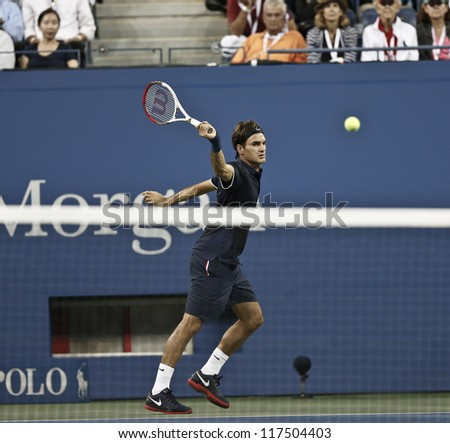 NEW YORK - AUGUST 27: Roger Federer of Switzerland returns ball during 1st round match against Donald Young of USA at US Open tennis tournament on August 2, 2012 in Flushing Meadows New York