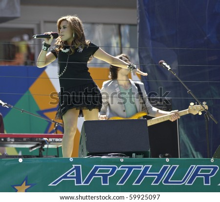 NEW YORK - AUGUST 28: Singer Demi Lovato performs at Arthur Ash stadium for Kids Day at US Open August 28, 2010 in New York City