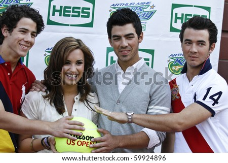 NEW YORK - AUGUST 28: The Jonas Brothers (L-R) Nick, Joe and Kevin and singer Demi Lovato arrive at the Arthur Ashe Kids Day at US Open August 28, 2010 in New York City