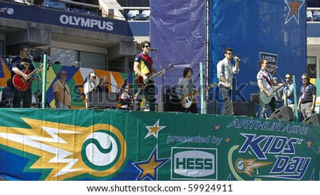 NEW YORK - AUGUST 28: The Jonas Brothers (L-R) Nick, Joe and Kevin perform during the Arthur Ashe Kids Day at US Open August 28, 2010 in New York City