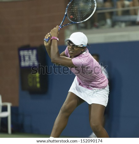 NEW YORK - AUGUST 29: Victoria Duval of USA returns ball during 2nd round match against Daniela Hantuchova of Slovakia at 2013 US Open at USTA Billie Jean King Tennis Center on August 29, 2013 in NYC