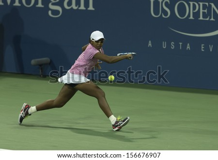 NEW YORK - AUGUST 29: Victoria Duval of USA returns ball during 2nd round match against Daniela Hantuchova of Slovakia at 2013 US Open at USTA Tennis Center on August 29, 2013 in New York
