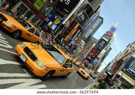 NEW YORK - AUGUST 28: Yellow taxi cabs rush tourists around Times Square on August 28, 2009 in New York City, NY.