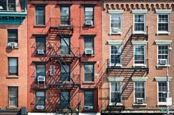 New York brick buildings with outside fire escape stairs, USA