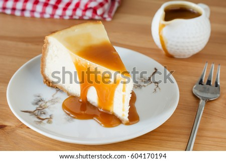 New York cheesecake with caramel sauce on a plate