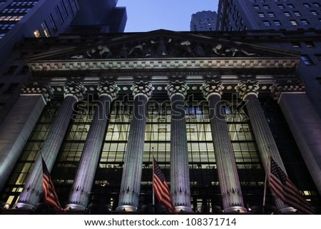 NEW YORK - CIRCA 2012: American flags flow in the wind at the New York Stock Exchange on Wall Street,  circa 2012 in New York City.