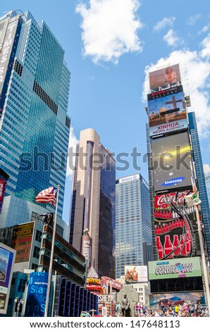 """NEW YORK - CIRCA MAY 2013: Times Square, New York, circa May 2013. It's a major commercial intersection, iconified as """"The Crossroads of the World"""", it's also the hub of the Broadway Theater District"""