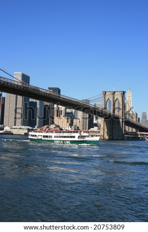 New York - Circle Line cruise ship passing under the Brooklyn Bridge, October 2008.