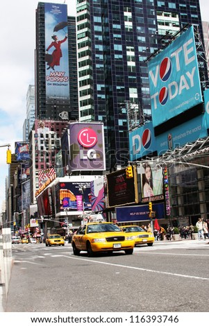 NEW YORK CITY - APR 18: Times Square, famous tourist attraction featured with Broadway Theaters and famous restaurant and store locations in New York City, April 18, 2010 in Manhattan, New York City.