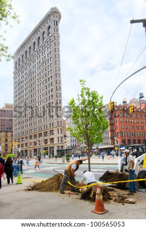 NEW YORK CITY - APR. 20:  Workers plant tree in NYC Union Square, Flatiron district on April 20, 2012.  MillionTreesNYC plans on planting a million trees in NYC over the next decade.
