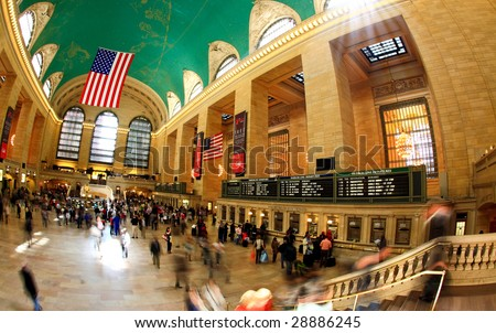NEW YORK CITY- APRIL 17 : A fisheye view of commuters and tourists flood the grand central station during the Friday afternoon rush hour April 17, 2009 in New York.