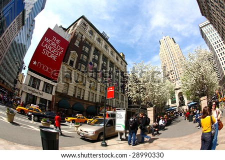 NEW YORK CITY- APRIL 17 : A fisheye view of people enjoy sunny spring days at the Herald Square in midtown Manhattan April 17, 2009 in New York.