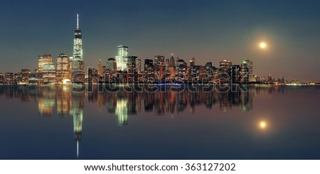 New York City at night with urban architectures reflections #363127202