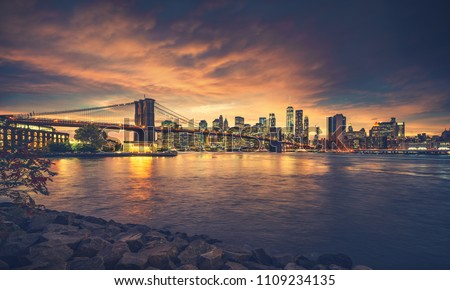 New York City at sunset. NYC famous postcard place at Brooklyn Bridge park with Brooklyn Bridge in front of image. #1109234135