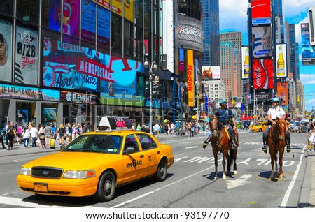 NEW YORK CITY - AUGUST 24: Police and taxi at a Times Square Intersection August 24, 2011 in New York, NY. It is the world's most visited tourist attraction bringing over 39 million tourists annually. - stock photo