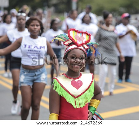 NEW YORK CITY - AUGUST 1 2014: the 47th annual West Indian Day Carnival parade on Labor Day filled Eastern Parkway with more than one million spectators celebrating Caribbean culture & heritage.