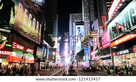 NEW YORK CITY - AUGUST 16: Times Square, featured with Broadway Theaters and animated LED signs, is a symbol of New York and the United States, August 16, 2012 in Manhattan