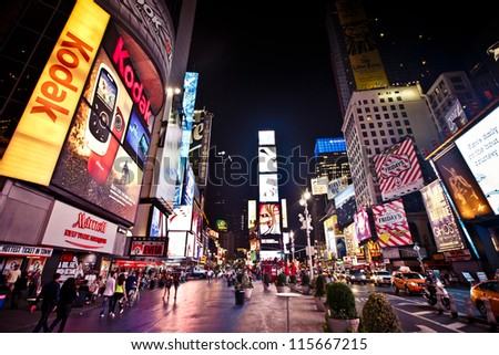 NEW YORK CITY - AUGUST 20: Times Square, is a busy tourist intersection of neon art and commerce and is an iconicplace  of New York City and USA on August 20, 2012 in Manhattan, New York City. - stock photo
