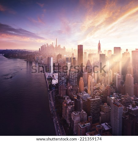 New York City - beautiful colorful sunset over manhattan fit sunbeams between buildings #221359174