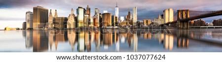 New York City - beautiful sunrise over manhattan with manhattan and brooklyn bridge USA #1037077624
