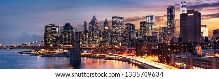 New York City - beautiful sunrise over manhattan with manhattan and brooklyn bridge USA #1335709634