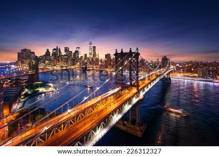 New York City - beautiful sunset over manhattan with manhattan and brooklyn bridge stock photo
