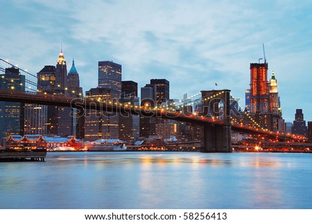 New York City Brooklyn bridge and Manhattan skyline at dusk.