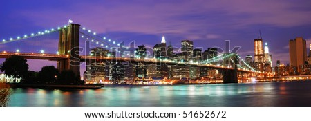 New York City Brooklyn bridge and Manhattan skyline night scene over Hudson River