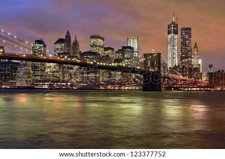 New York City - Brooklyn Bridge with Manhattan skyline at night, USA
