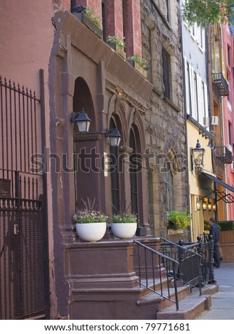New York City brownstone apartments along a quiet street