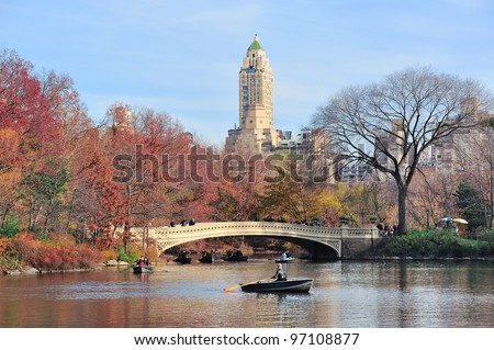 New York City Central Park in Autumn in midtown Manhattan with colorful foliage and boat in lake
