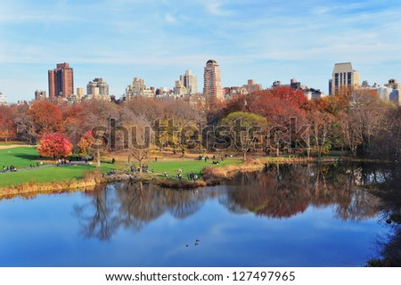 New York City Central Park in Autumn with lake and foliage.