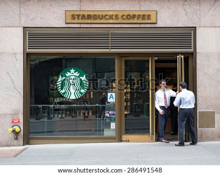 NEW YORK CITY - CIRCA MAY 2015: People in front of Starbucks store close to Grand Central Station. Starbucks is the largest coffeehouse company in the world.